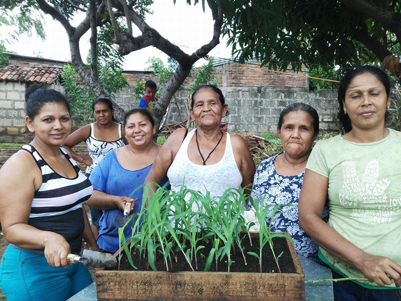 members of La Fortaleza with seed box