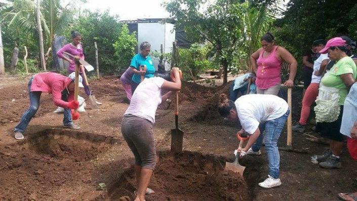 women digging